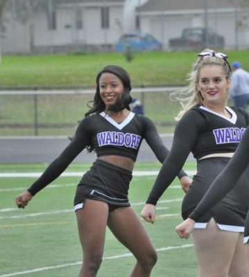 Two Waldorf Cheerleaders doing a routine during halftime