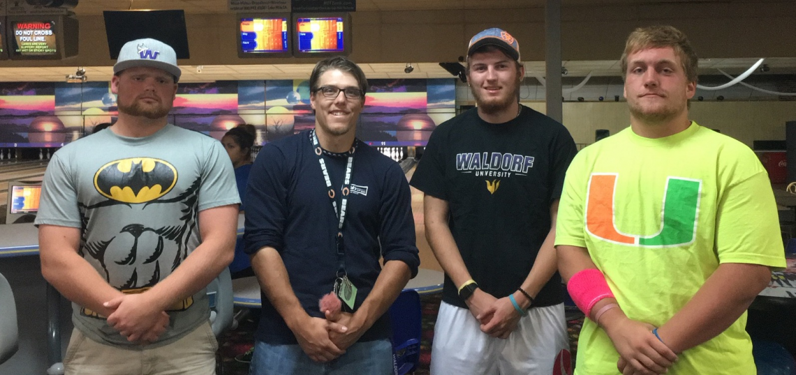Image - Four males standing side by side in a bowling alley